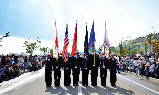 U.S. Navy Honor Guard from Misawa, Japan, marches in the 2015 Aomori Ten City Parade in Mutsu, Japan