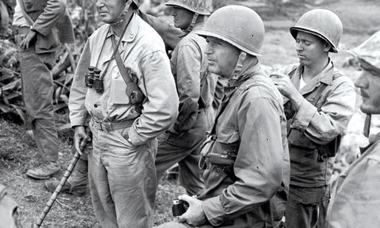 "Lieutenant General  Lemuel Shepherd (left, as a major general overlooking Naha on Okinawa) noted the Marine Corps' contributions to amphibious operations, but just as important is its role as a ""ready-to-act military organization, responsive . . . to the President's call to meet the crises which occur in both peace and war."""