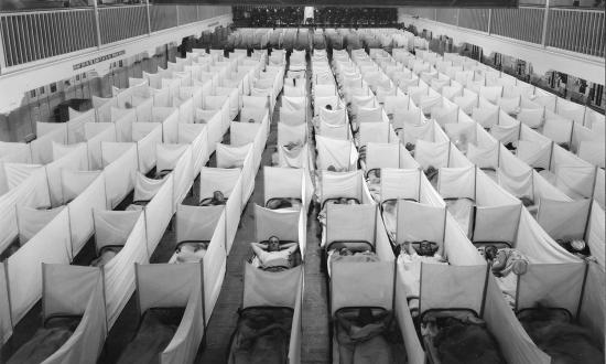 "During the influenza pandemic of 1918, the Navy took precautions—such as erecting ""sneeze guards"" in crowded sleeping areas—but the most effective  defense against spread of the deadly disease was quarantine."