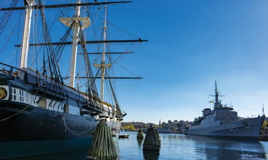 USS Constellation and the training ship Brasil moored in Baltimore's Inner Harbor