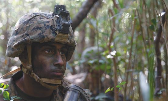 A U.S. Marine scans the area at the Jungle Warfare Training Center (JWTC), Camp Gonsalves, Okinawa, Japan, on Mar. 12, 2019