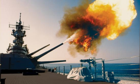 "Targeting Iraqi assets in Kuwait, the USS Wisconsin (BB-64) fires a round from one of her Mark 7 16-inch/50-caliber guns in turret no. 1, adding her firepower to a war that necessitated a shift from ""widely accepted doctrines and methods of operation."""