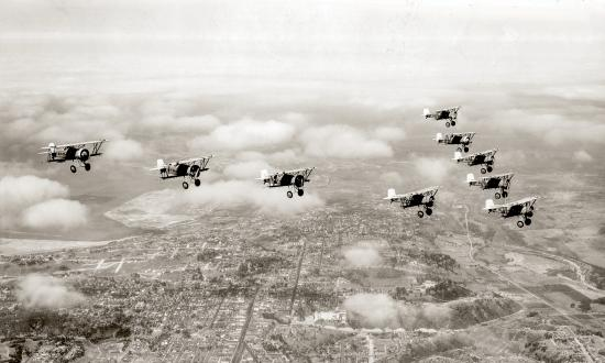 Air-to-air view of Curtiss F6C fighters fly in formation over San Diego in 1931