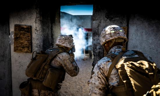 Marines from 1st Battalion, 7th Marine Regiment, clear a building at the Twentynine Palms Military Operations on Urban Terrain (MOUT) Center.  Such facilities can be better for training than operational testing, because restricted military training grounds lack robust civilian populations or major urban centers and are not representative information environments.
