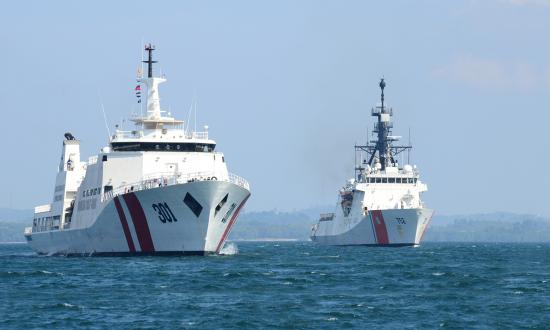 The USCGC Stratton (WMSL-752), shown here transiting the Singapore Strait alongside the Indonesian vessel KN Tan Jun Datu.
