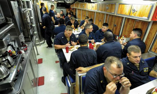 Sailors assigned to the Virginia-class fast attack submarine USS Indiana (SSN-89) eat dinner in the crew's mess while under way