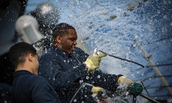 Machinist Mate 2nd Class Dezmond Twymon of the USS Porter (DDG-78) patches a ruptured pipe during the Porter's damage control olympics in 2018