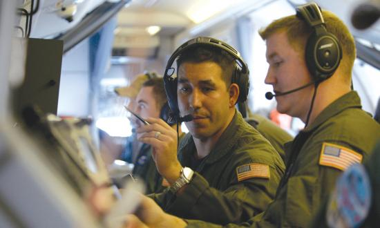N SEA (Nov. 17, 2016) Petty Officer 2nd Class Luis Hernandez, center, and Petty Officer 2nd Class Kenneth Lovett conduct acoustic operator duties aboard the P-8A Poseidon aircraft during a qualification training, Nov. 17, 2016