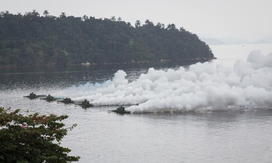 Brazilian amphibious assault vehicles lay smoke