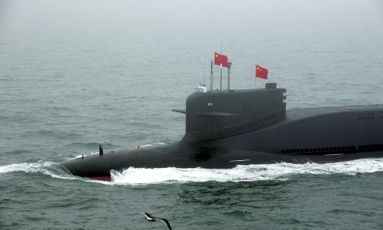 A new type of nuclear submarine of the Chinese People's Liberation Army (PLA) Navy is reviewed during a naval parade