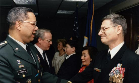 Chairman of the Joint Chiefs General Colin Powell greets Captain Swartz at his retirement ceremony in 1993