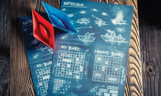 Stock image of game board with paper ships