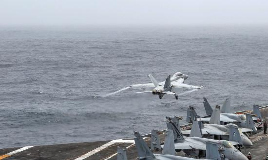 An F/A-18 Super Hornet attached to Strike Fighter Squadron 143 launches from the flight deck of the USS Abraham Lincoln (CVN-72) in the U.S. Fifth Fleet area of operations
