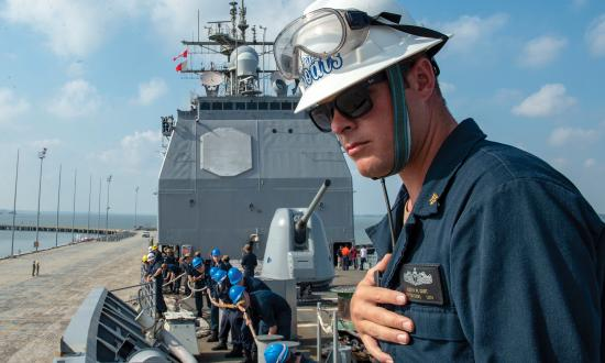 A chief boatswain's mate observes for safety as sailors handle lines during sea and anchor detail on board the guided-missile cruiser USS Vella Gulf (CG-72). A culture in which sailors choose the safest approach is far more effective than one in which safety is enforced from above.