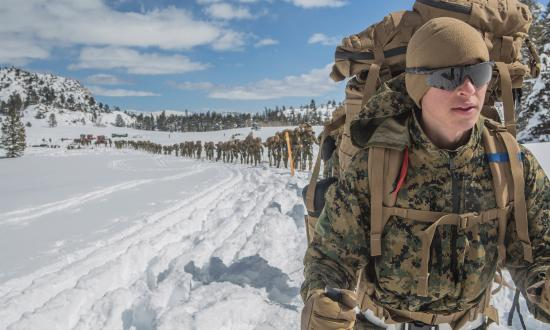 Marine prepares for a conditioning hike during a deployment for training exercise at Mountain Warfare Training Center, Bridgeport, CA