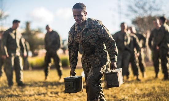 A Marine sprints with two ammo cans during the maneuver-under-fire portion of the combat fitness test, which complements the Marine Corps physical fitness test. A growing body of research shows a strong correlation between physical fitness and cognitive acuity. Exercise protects and creates new brain cells and activates the learning process, which is essential to outthinking and outsmarting adversaries.