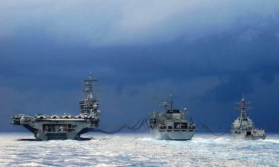 USNS Arctic (T-AOE 8) conducts an early morning Replenishment at Sea with USS Dwight D. Eisenhower (CVN-69) and USS Anzio (CG-68).
