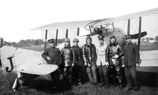 A Sempill Mission British flying instructor stands with Japanese naval aviators