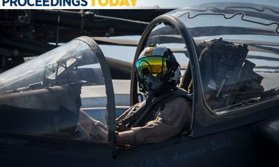 Marine Harrier pilot on board the USS Iwo Jima (LHD-7)