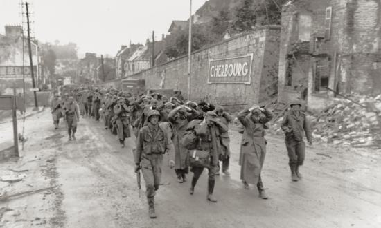 U.S. soldiers march German prisoners of war through Cherbourg on 28 June 1944