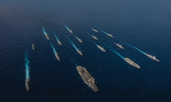 Aerial overhead view of ships from the U.S. Navy and Japan Maritime Self-Defense Force (JMSDF) in formation