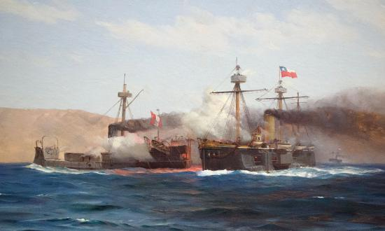8 October 1879: Smoke fills the air in the engagement between the Peruvian turret ship Huáscar (left) and the Chilean central battery ship Almirante Cochrane—the culmination of the naval side of the War of the Pacific. The battle resulted in the Chilean Navy's capture of the Huáscar, which lives on as a museum ship.