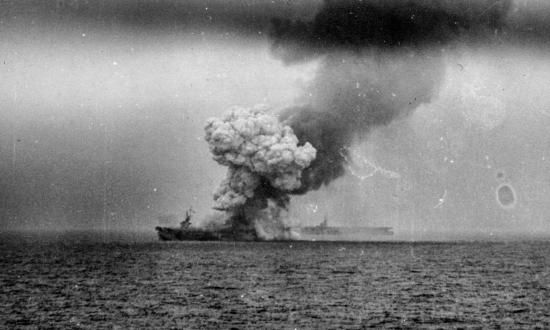 Smoke rising from the USS St. Lo after hits from a kamikazes