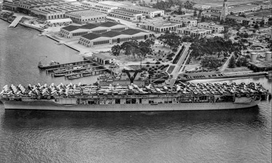 USS Yorktown (CV-5) docked at a pier at North Island, California, May 1940.