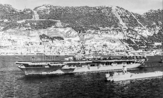 The USS Valley Forge (CV-45) steams out of the harbor at Gibraltar enroute to Bergen, Norway.