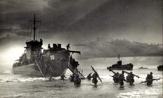 Troops from USS LCI(L)-30 reach the beach in the second wave of the invasion of Sarmi, Dutch New Guinea