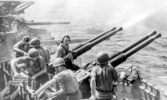 A gun crew on board the USS Hornet (CV-12) fires its quad-mount Bofors 40-mm in 1945