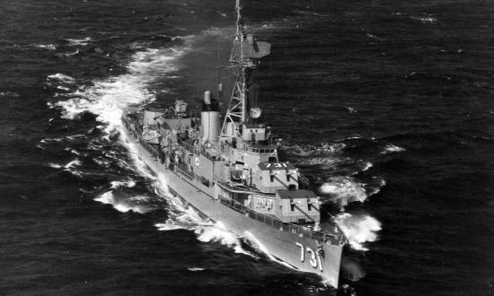 Aerial starboard bow view of the USS Maddox (DD-731) underway.