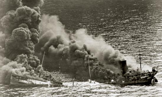 An Allied tanker sinks into the Atlantic after being torpedoed by a U-boat.