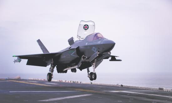An F-35B Lightning II assigned to Marine Fighter Attack Squadron 211 (VMFA), 13th Marine Expeditionary Unit (MEU), makes final preparations to land aboard the Wasp-class amphibious assault ship USS Essex (LHD 2), Jan. 9, 2019