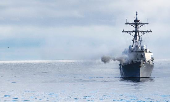 The USS Pinckney (DDG-91) fires her forward gun.
