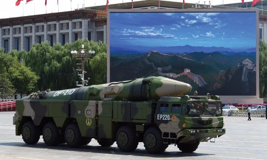 A military vehicle carries DF-21D missile past a display screen featuring an image of the Great Wall of China at Tiananmen Square in Beijing on September 3, 2015