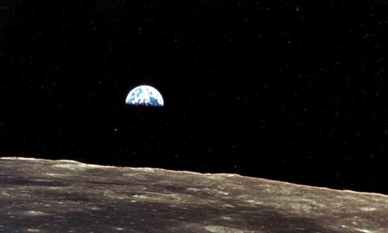 Earthrise over the moon as seen from Apollo 11
