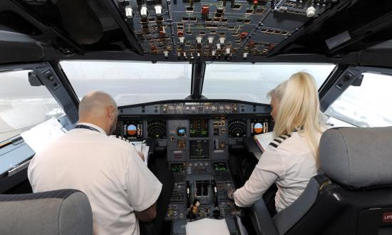 Air Serbia Airbus A319 Crew members captain Davor Miseljic and copilot Biljana Savic prepares for flight at Zagreb airport on December 12, 2014 in Zagreb