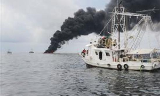 A Mess in the Gulf Crew members of the Gulf Handler, a contracted fishing vessel, observe a controlled oil burn in the Gulf of Mexico on 5 May. Locals conducted the in-situ burn in partnership with BP, the U.S. Coast Guard, and other federal agencies to a