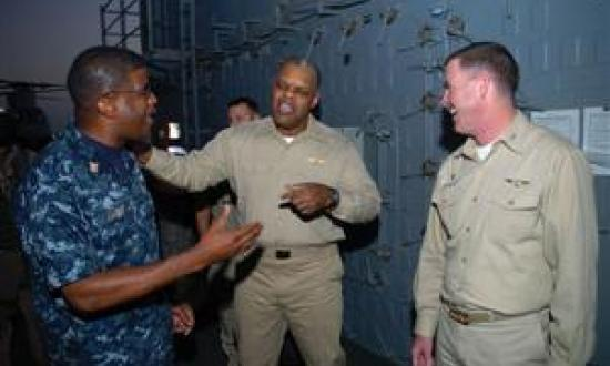 Providing honest feedback to all levels in the chain-of-command is a Chief's most important responsibility, the author says. Here, Rear Admiral Sinclair Harris (center), commander of Expeditionary Strike Group 5, speaks with Captain Kevin Couch, commandin
